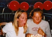 Nancy Cooper, right, and identical twin Krista, left, blow out  birthday candles in an undated photo. (Photo courtesy of Jill Dean)