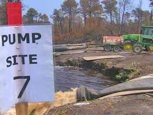 Wildfire burns on, despite flooded canals