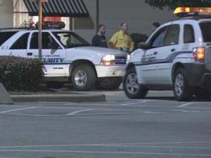 Police gathered at the Triangle Town Center mall in Raleigh after an altercation involving more than 100 people on July 26, 2008.