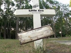 "A new white cross, decorated with artwork, marks the grave of pop-music star Little Eva, or Eva Narcissus Boyd, at the Black Bottom Cemetery in her hometown of Belhaven, N.C. Little Eva got a No. 1 hit with ""The Loco-Motion"" in 1962."