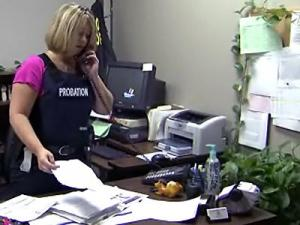 Probation officers, like Jennifer MacNeil, in the Wake County probation office handle caseloads that vary from 20 files to more than 100.