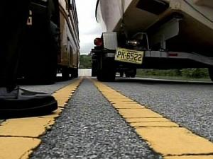 State troopers show the distance between a bus and a trailer towing a boat if a law easing restrictions passes. Gov. Mike Easley has vetoed the bill.