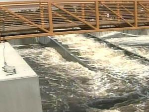 Water cascades down a fish ladder of the Hope Mills Lake dam on Aug. 29, 2008.