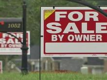 Rolesville homeowners protest with a forest of 'for sale' signs