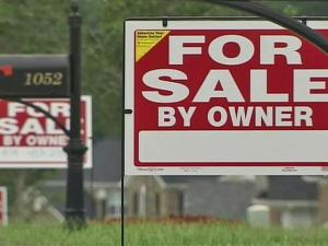 Homeowners in Rolesville's Hampton Pointe subdivision have planted a forest of 'for sale by owner' signs as a protest against plans to make a neighborhood Road the main entrance and exit for buses to a middle school under construction.