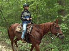 A visitor rides a horse along one of the trails at Umstead State Park on Sept. 20, 2008.
