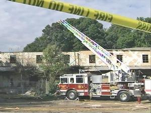Investigators combed through the wreckage, while firefighters put out hot spots inside Hunter and Co. Painterswork in Raleigh on Sept. 22, 2008, a day after a massive fire ripped through the building. The building houses several businesses, including a few woodworking shops, and owners came to salvage what they could.