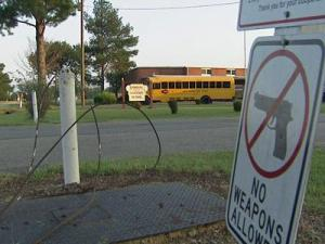 A No Weapons sign is posted outside Dawson Elementary School.