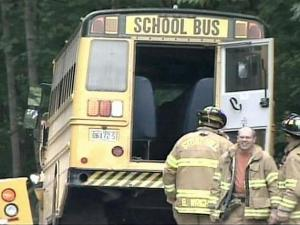 Authorities charged a Wake Forest woman with DWI Wednesday after she side-swept this school bus carrying 35 students to Wakefield High.