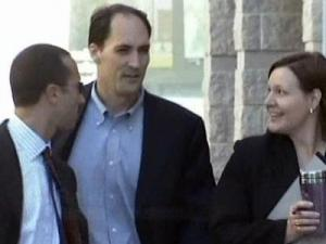 Brad Cooper, center, enters the law firm of Tharrington & Smith Oct. 2, 2008, with his attorneys, Howard Kurtz and Lynn Prather, to give a deposition in the custody case involving his two young daughters.