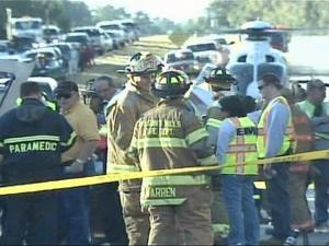 Paramedics and firefighters surround a medical helicopter that landed on U.S. Highway 70 in Selma to fly the victim of a five-vehicle wreck to WakeMed in Raleigh on Monday, Oct. 20, 2008. The wreck involved a school bus, garbage truck, tractor and two cars and shut down U.S. 70, near Buffalo Road, for two hours.