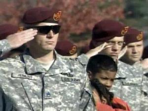 Soldiers salute at a ceremony at Fort Bragg on Nov. 11, 2008, to unveil two memorial stones in honor of the 550th Airborne Infantry Battalion and the 321st Field Artillery Regiment.