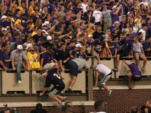 East Carolina fans jump down to the field to celebrate the Pirate's 24-3 win over West Virginia on Sept. 6, 2008.
