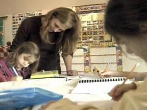 Wendy Vidrine works on school assignments with her children. Vidrine homeschools her eight children.