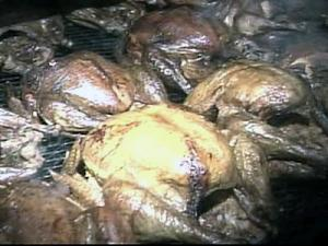 Turkeys roast overnight Wednesday so they will be ready for the Durham Rescue Mission's traditional Community Dinner on Thanksgiving.