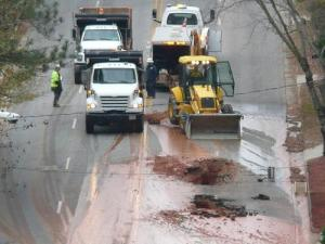 Crews work to repair a water main break on Wade Avenue Tuesday morning. (Photo courtesy of Greg Flynn)