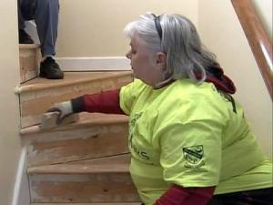 A volunteer with Homeworks, a non-profit organization that repairs, maintains or modifies homes for free for people in need, works on Maud Williams' Cary home on Dec. 13, 2008.