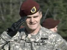 """Capt. Scott McKay, company commander of the 1st battalion, 504th Parachute Infantry Regiment, salutes during a drill. Ninety members of the unit will march as part of """"America's Guard of Honor"""" in President-elect Barack Obama's inaugural parade."""