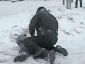 An East Carolina University police officer restrains a student after a campus snowball fight. (Photo courtesy of YouTube.com)