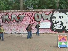 A large portrait of North Carolina State University women's basketball coach Kay Yow, who died one week ago from breast cancer, was defaced by blue graffiti and profanity Saturday night.