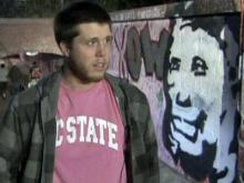 Members of the North Carolina State University student government painted over the blue graffiti and phrases celebrating cancer that were written over a spray-painted tribute to N.C. State's longtime women's basketball coach.