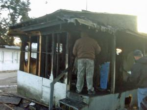 Wilson County firefighters examine the ruins of a shed where they fought a fire Thursday morning, Febv. 5, 2009, at Mildred's Flea Market, 3122 U.S. Highway 301 S.