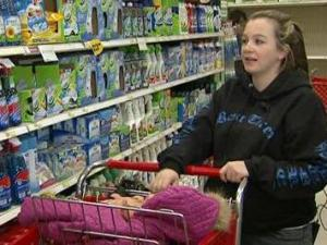 Kelly Reaves, who has children in her house and a baby on the way, shops for household cleaners.