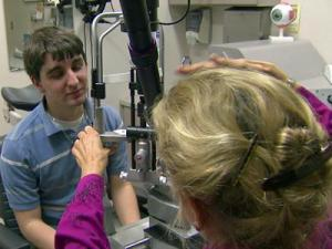 Duke ophthalmologist Dr. Sharon Freedman examines Kyle Street's eyes. Street first came to Durham nine years ago, at age 6, for treatment of glaucoma.