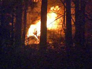 A fire broke out in a wooded area with several vehicles in it, off the 1500 block of Josephine Road in the Cleveland community in Johnston County, early Saturday, Feb. 14, 2009.