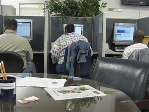 Unemployed workers search for jobs at the Raleigh office of the Employment Security Commission of North Carolina.
