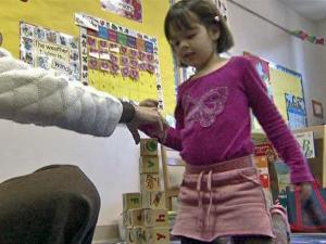 Assistance from the Cary-based Christian Community in Action nonprofit helps 4-year-old Angie go to day care while her father, Dennis Lamount, looks for work.