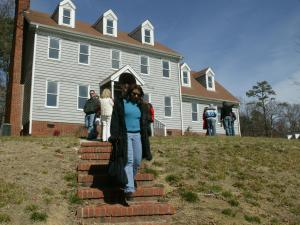 People tour a foreclosed home on Feb. 21, 2009. The bus tour of foreclosed properties was created by realtor Jeanna Reeves.