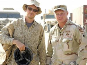 """Filmmaker Jake Rademacher, left, with his brother, Capt. Isaac Rademacher, in Iraq during the filming of """"Brothers at War."""" Isaac Rademacher is now a major stationed at Fort Bragg."""