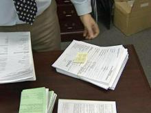 A stack of worthless check warrants sits on Magistrate Judge Jeffrey Rowland's desk.