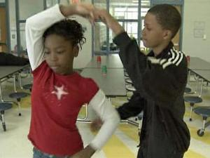 Students dance together in Washington Elementary School's ballroom dancing club.