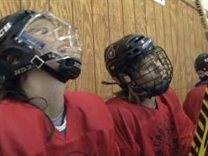 Two members of the Carolina Black Widows enjoy a moment of laughter during a game. The Triangle-based team is the only USA Hockey-affiliated team in North Carolina for women more than 30 years old.
