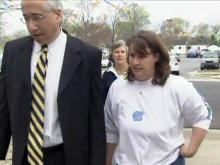 Former Johnston County Assistant District Attorney Cyndi Jaeger walks to the Johnston County Courthouse with her attorney, David Freedman, on April 1, 2009.
