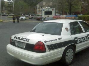 Police were investigating the deaths of two people found inside a Durham apartment at 4800 University Drive on April 11, 2009.