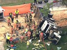 A dump truck overturned onto a car Monday, April 13, 2009, in the 1300 block of Davis Street north of Apex. Rescue workers worked for two hours to extricate a woman trapped in the car.
