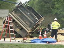 Paramedic rescues woman pinned by dump truck
