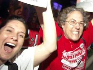 Hundreds of Carolina Hurricanes fans cheered as their team arrived at RDU Airport early Wednesday after beating the New Jersey Devils 4-3 Tuesday night with one of the greatest last-minute comebacks in NHL history.
