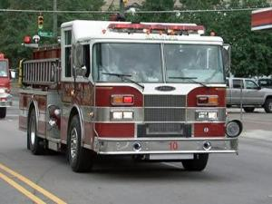 A fire truck parades down Hillsborough Street in Raleigh on May 2, 2009 in honor of fallen firefighters.