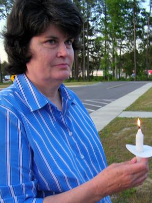 Juanita Jackson, the wife of a fallen Johnston County police officer, participates in a candlelight vigil at the Johnston County Community College Public Safety Training Center on May 12, 2009. (Submitted by Joseph M. Brady)