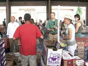 People make purchases at the State Farmers Market on May 30, 2009.