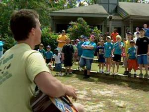 Children at a local 4H camp enjoy some music.