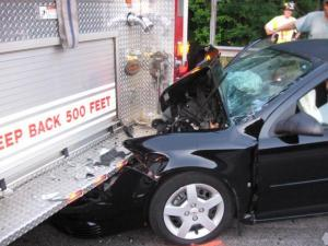 Two North Carolina State University students were involved in a crash Saturday morning when their car hit the back of a parked fire truck that was responding to a vehicle fire on Interstate 40. (Photo courtesy of the Morrisville Police Department.)