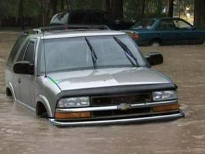 A car along Fountain Drive in Raleigh was submerged in flood waters on June 16, 2009.