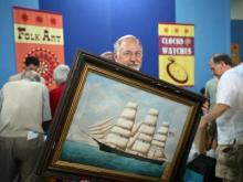 "The ""Antiques Roadshow"" taped Saturday, June 27, 2009, at the Raleigh Convention Center, where over 5,000 ticket holders lined up to learn what their flea market finds or family heirlooms were financially worth."