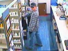 A surveillance photo of one of the suspects accused of robbing McPhail's Pharmacy, 815 W. Front St. in Lillington, on July 8, 2009.