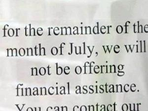 A sign hangs on the door of the Wake County of the Salvation Army informing people that they are unable to offer financial assistance for the remainder of July.